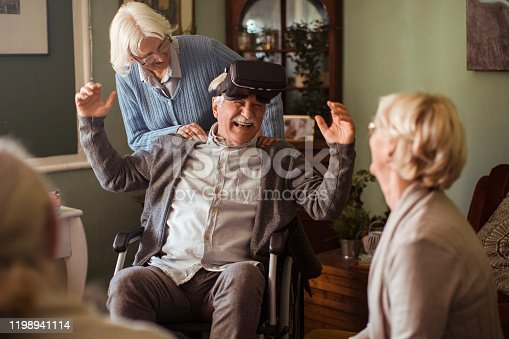 1053414472 istock photo Seniors using VR 1198941114