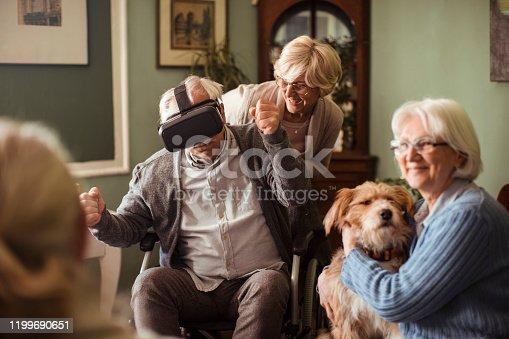 1053414472 istock photo Seniors using VR 1199690651