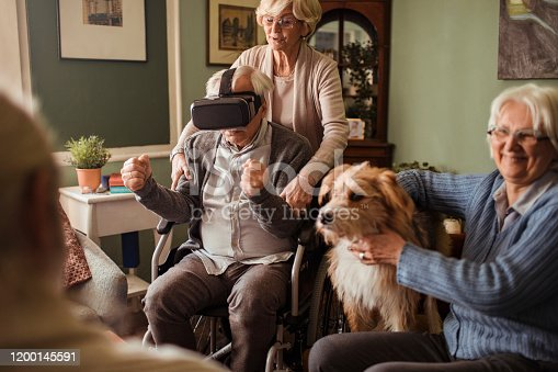 1053414472 istock photo Seniors using VR 1200145591