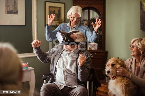 1053414472 istock photo Seniors using VR 1200145793