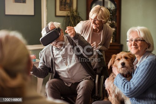 1053414472 istock photo Seniors using VR 1200146805