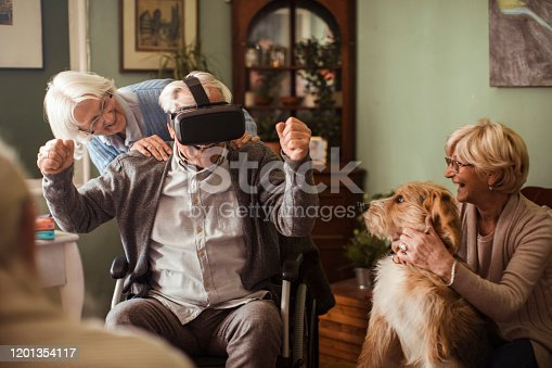 1053414472 istock photo Seniors using VR 1201354117