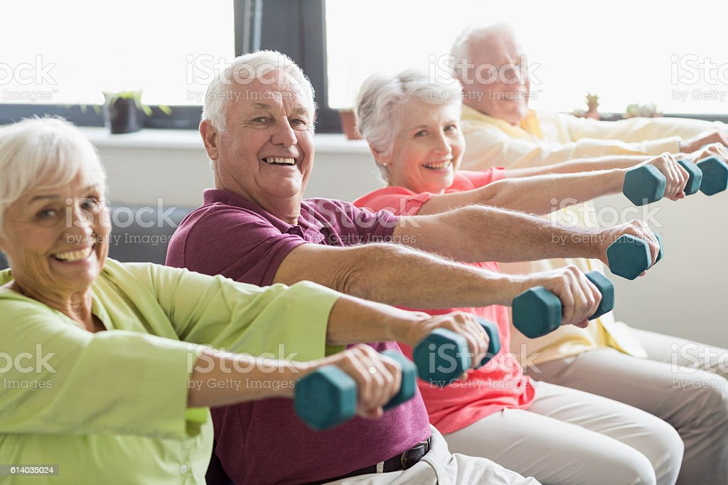 Seniors using weights stock photo