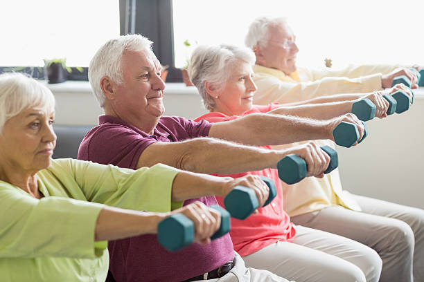 seniors using weights - relaxation exercise stock photos and pictures