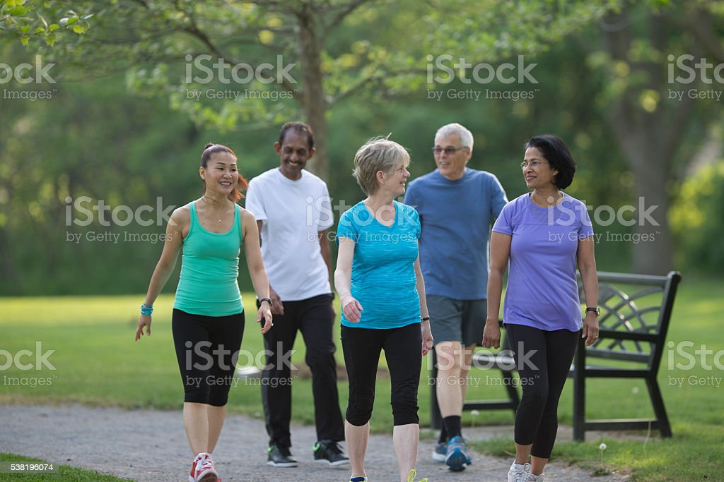 Seniors Walking Together at the Park stock photo