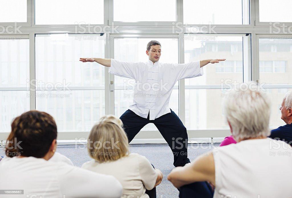 Seniors Watching Tai Chi Exercises royalty-free stock photo