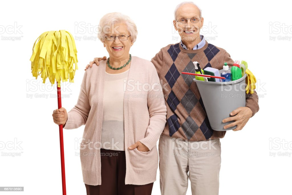 Seniors with a mop and cleaning products Lizenzfreies stock-foto