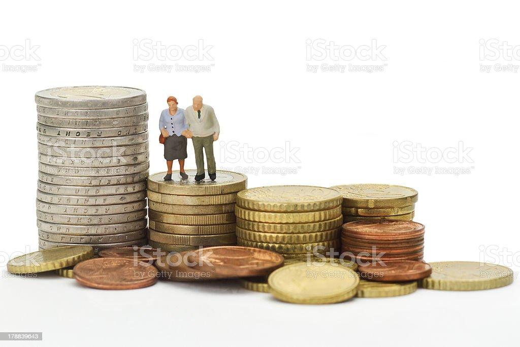 Seniors with euro coins stock photo