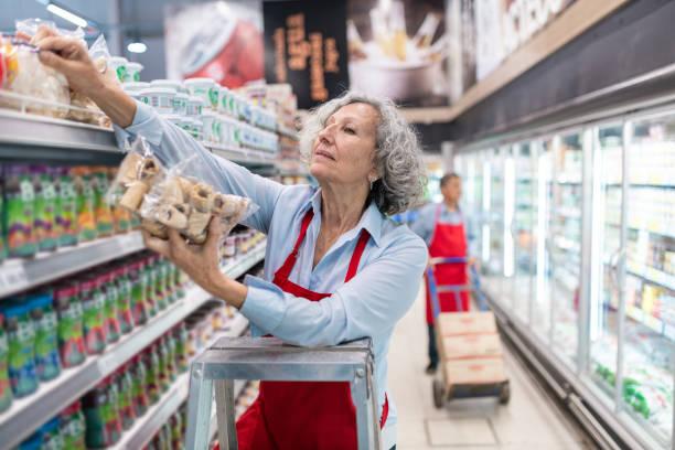Seniors working in Supermarket stock photo
