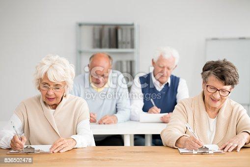 istock Seniors writing test 836502478