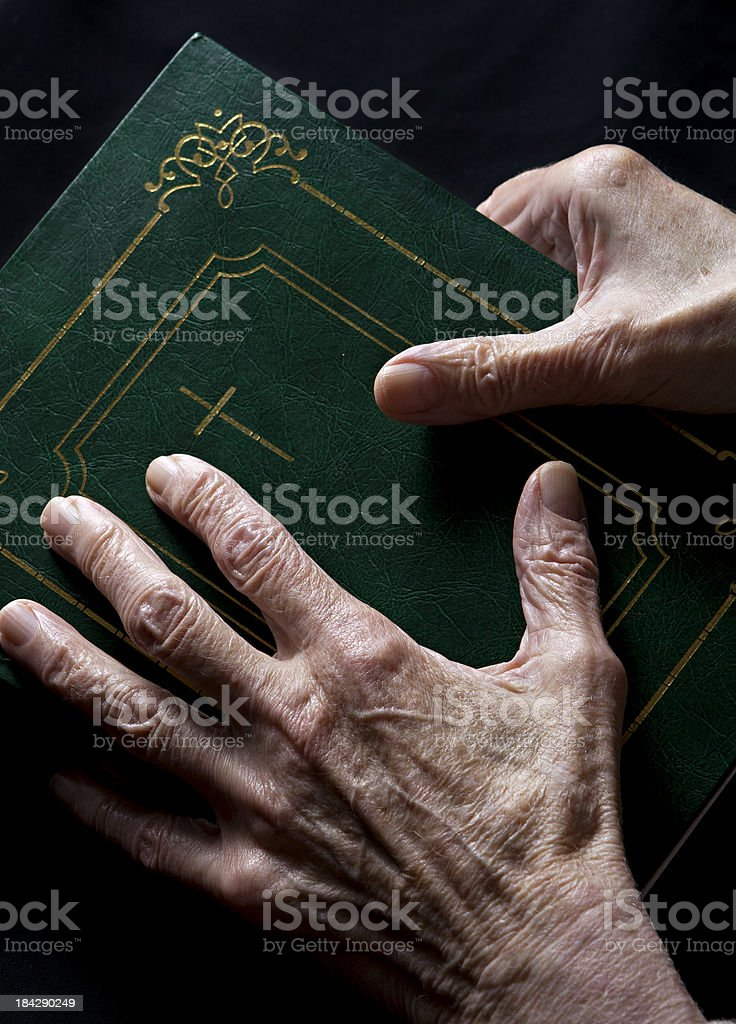 seniors's hands on bible royalty-free stock photo