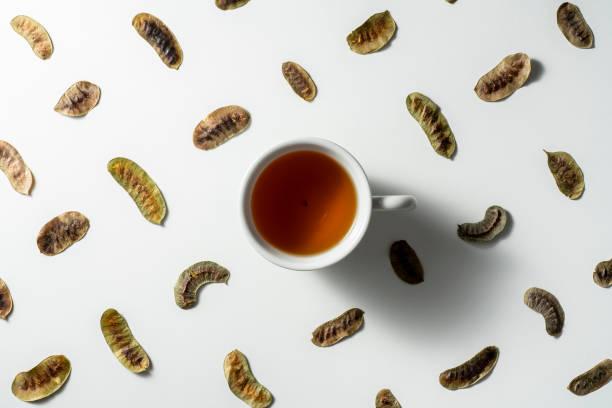 Senna tea and dried senna leaves stock photo