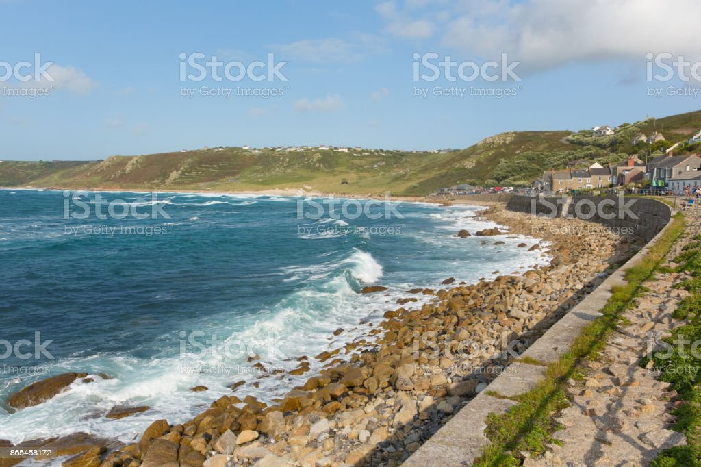 Sennen Cove seafront Cornwall with blue sea and sky and breaking waves stock photo