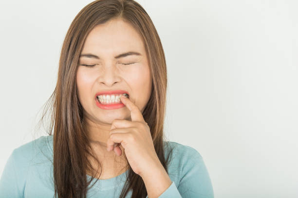 Sensitive teeth in woman And  of cold water stock photo