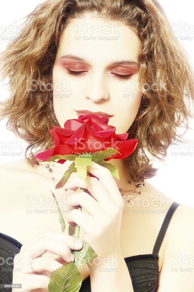 Sensitive woman with red rose in high-key royalty-free stock photo