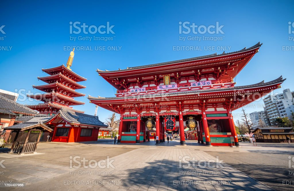Sensoji (Senso-ji) temple at Asakusa, Tokyo, Japan April 3, 2019 - Tokyo, Japan: Senso-ji Temple, the oldest temple located in Tokyo, and Nakamise-dori connecting the Kaminarimon entrance to the main hall, are constantly crowded with sightseers on a yearly basis. Since the area has always had a large number of temples since the Edo Period, it has been called Teramachi, which translates to 'City of Temples' Architecture Stock Photo