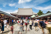 Tokyo, Japan - August 24, 2015: People, captured with blurred motion, visit the famous Senso-ji Buddhist temple in Asakusa historic district of Tokyo, Japan capital city.