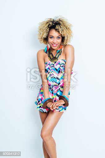 istock Sensual afro american young woman in summer outfit 520541312