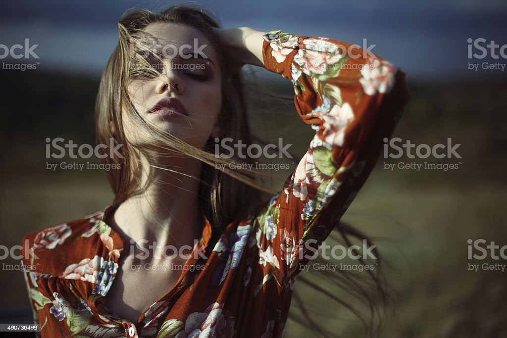 sensual beautiful young woman with developing hair stock photo