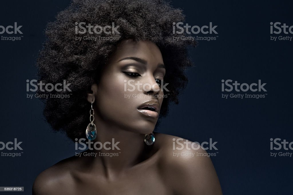 sensual black woman wearing luxury jewellery stock photo