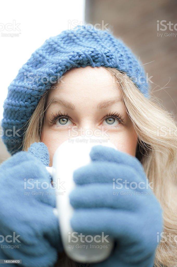 Sensual blond enjoying hot drink outside royalty-free stock photo