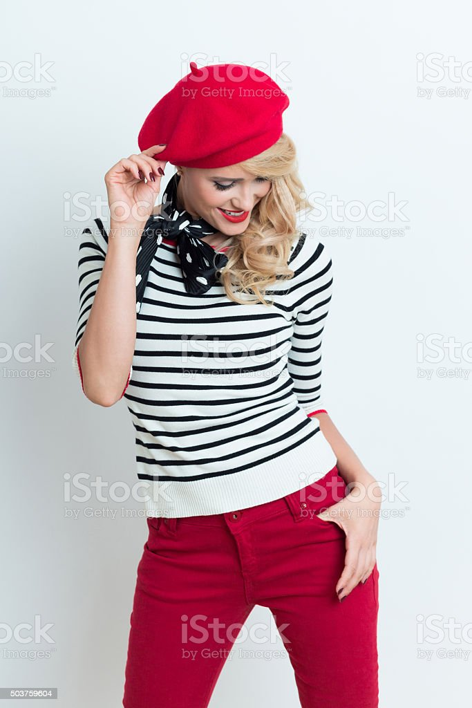 Sensual blonde french woman wearing red beret Portrait of sensual beautiful blonde woman in french outfit, wearing a red beret, striped blouse and neckerchief. Adult Stock Photo