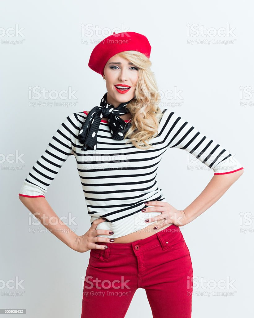 Sensual blonde french woman wearing red beret Portrait of sensual beautiful blonde woman in french outfit, wearing a red beret, striped blouse and neckerchief, smiling at camera. Adult Stock Photo