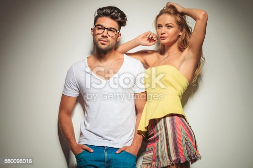 1092709104istockphoto sensual blonde woman resting her hand on her man 580098016