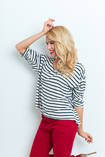 Sensual Blonde Woman Wearing Striped Blouse Stock Photo - Download Image Now