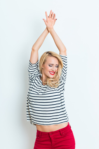 Sensual Blonde Woman Wearing Striped Blouse Raised Arms Stock Photo - Download Image Now