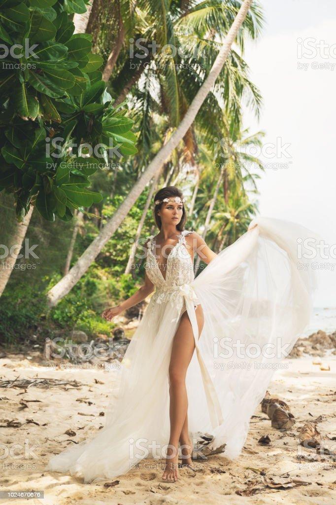 ca2f39cfdbb Sensual Bride Wearing Beautiful Wedding Dress On The Tropical Island ...