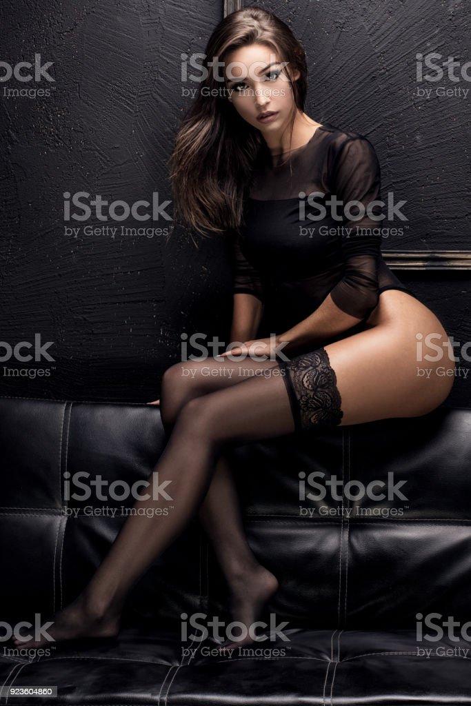 Sensual brunette girl in stockings. stock photo