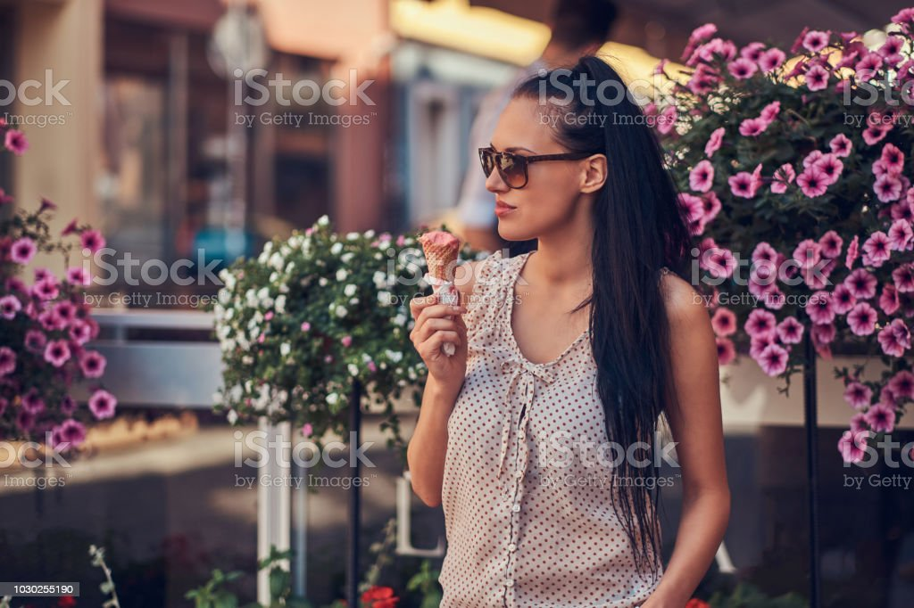 Sensual brunette girl in sunglasses wearing trendy clothes is...