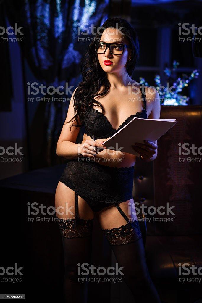 Sensual brunette in black lingerie indoors stock photo