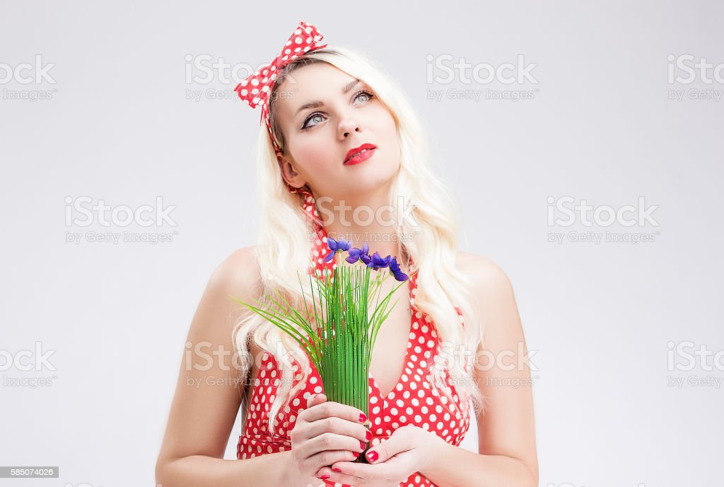 Sensual Caucasian Blond Female in Red Polka Dotted Dress Dreaming stock photo