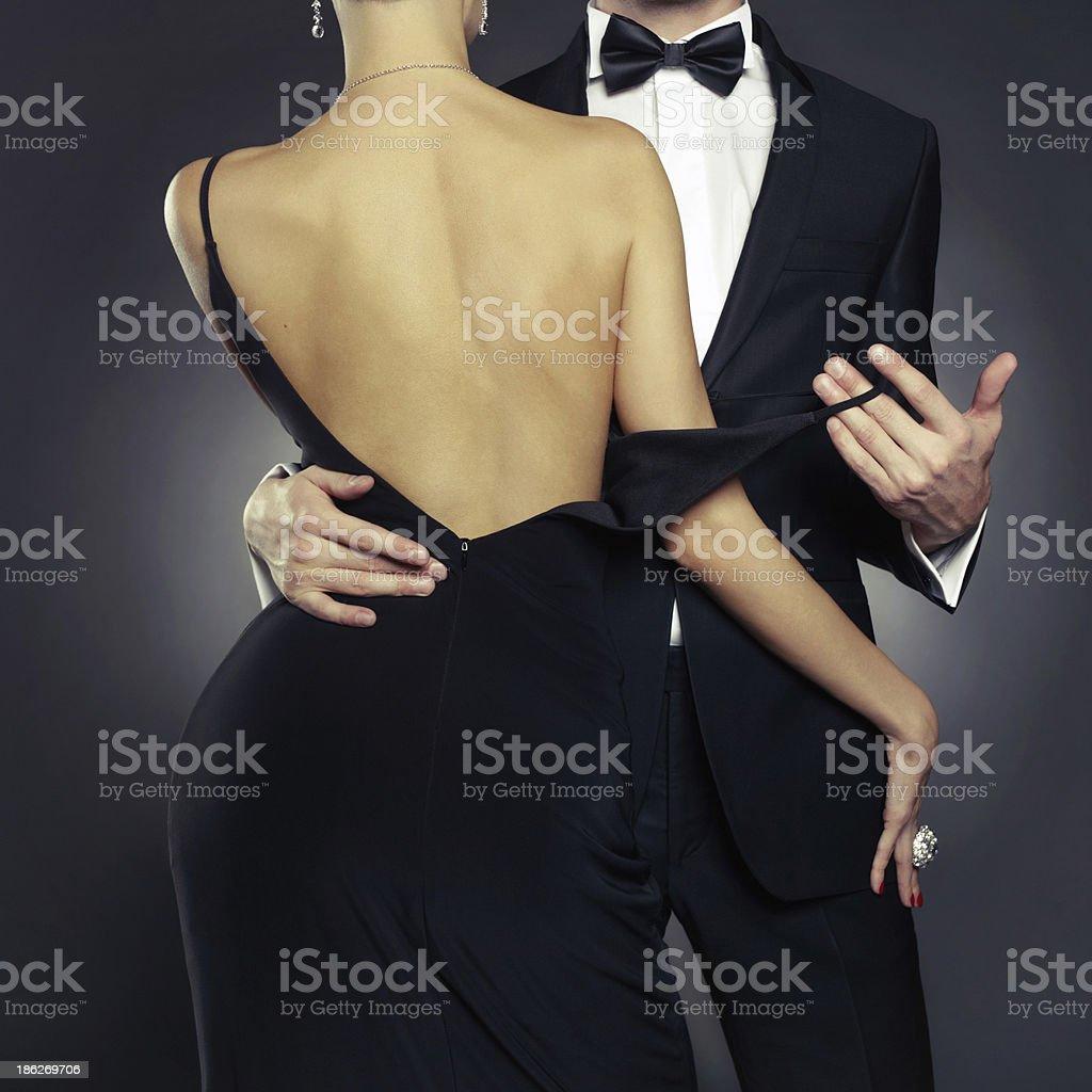Sensual couple in formal attire stock photo