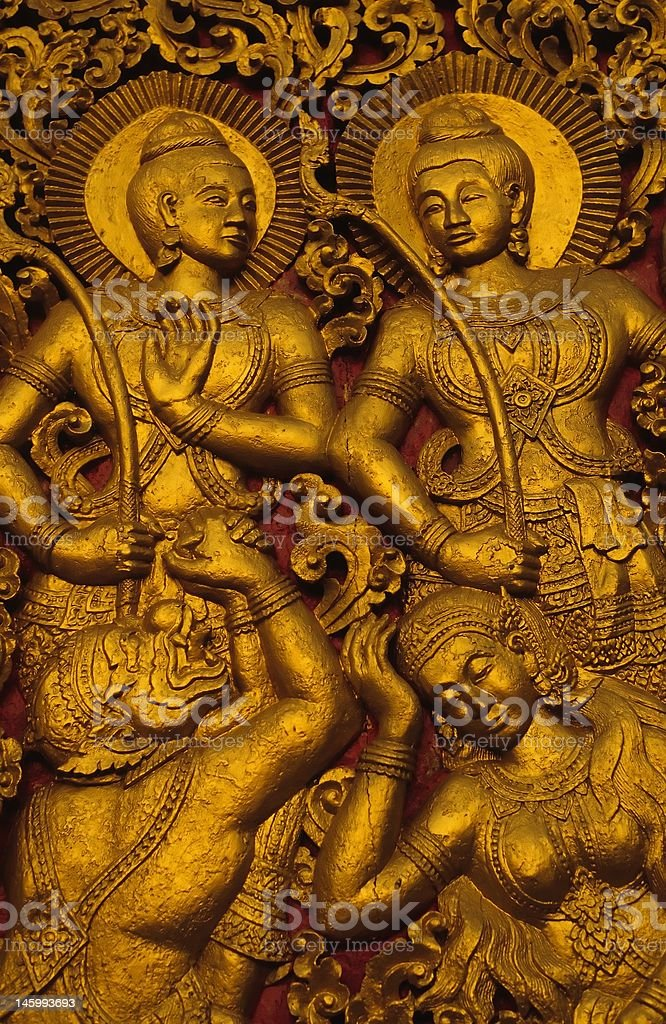 sensual figures at temple in Laos stock photo