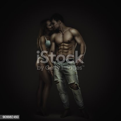 Artistic portrait of young athletic man and woman