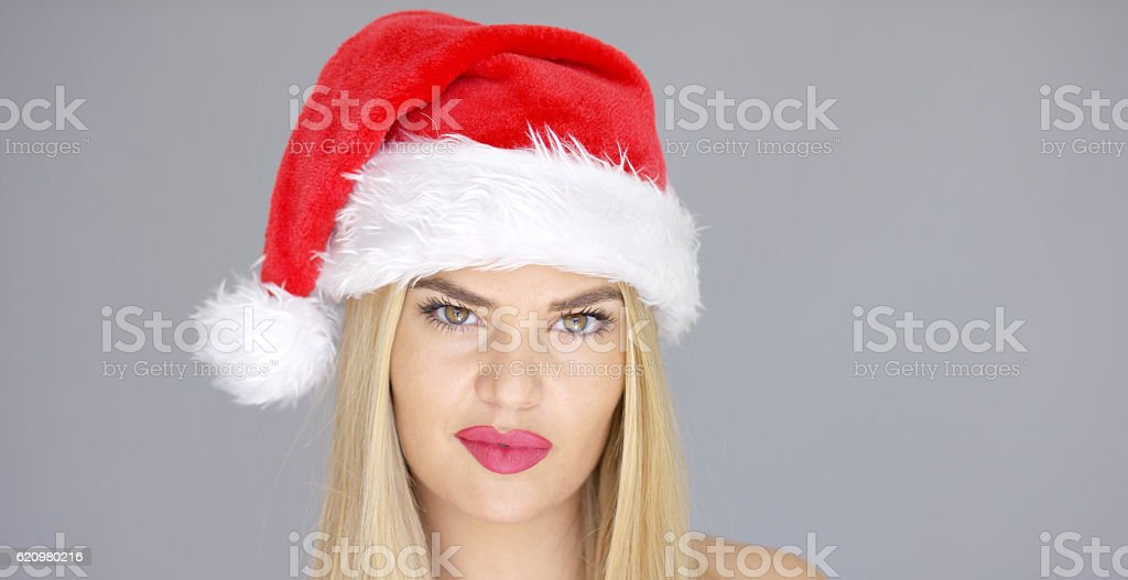 Sensual girl in Santa Claus hat posing isolated on gray foto royalty-free