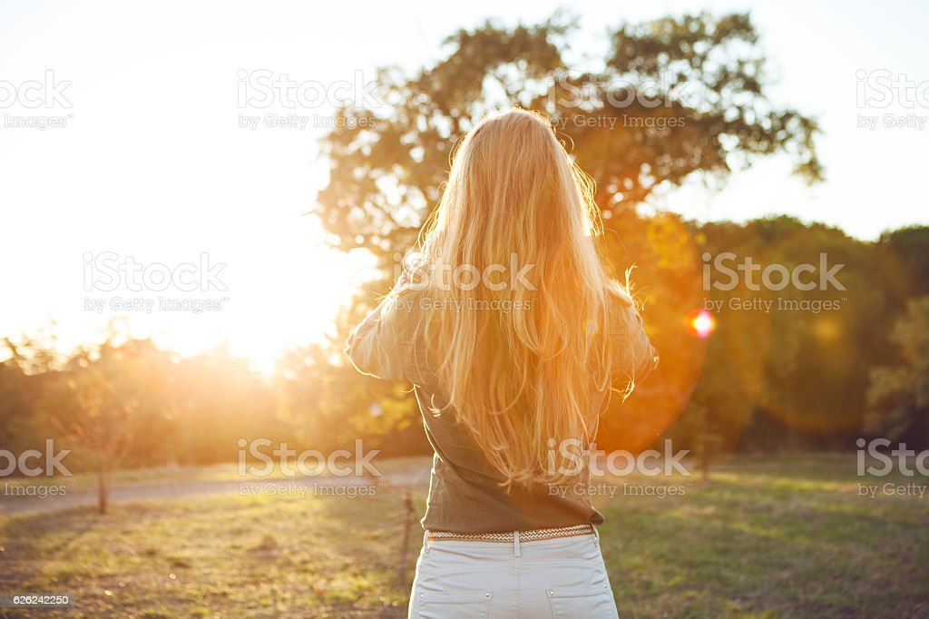 Sensual girl in sunset stock photo