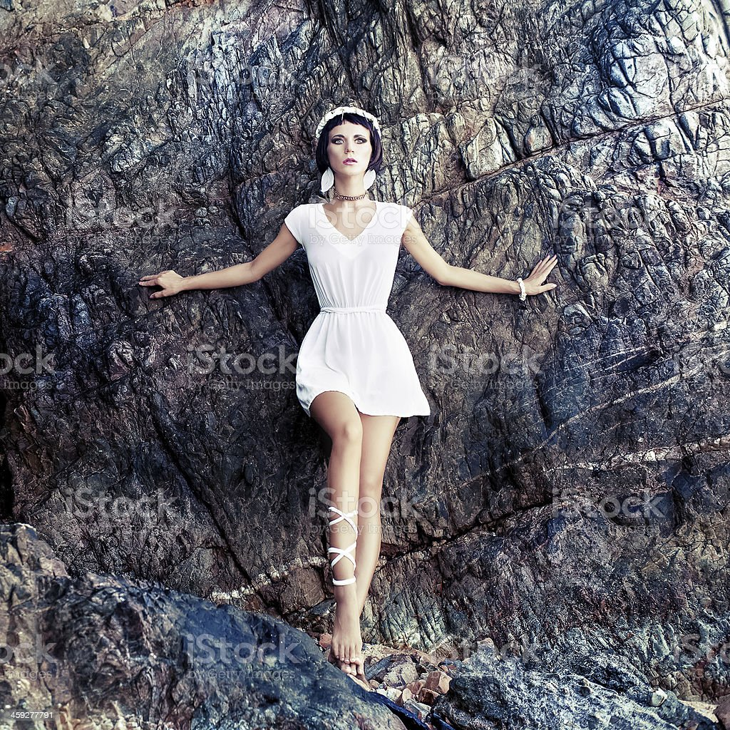 sensual girl on the rocks stock photo
