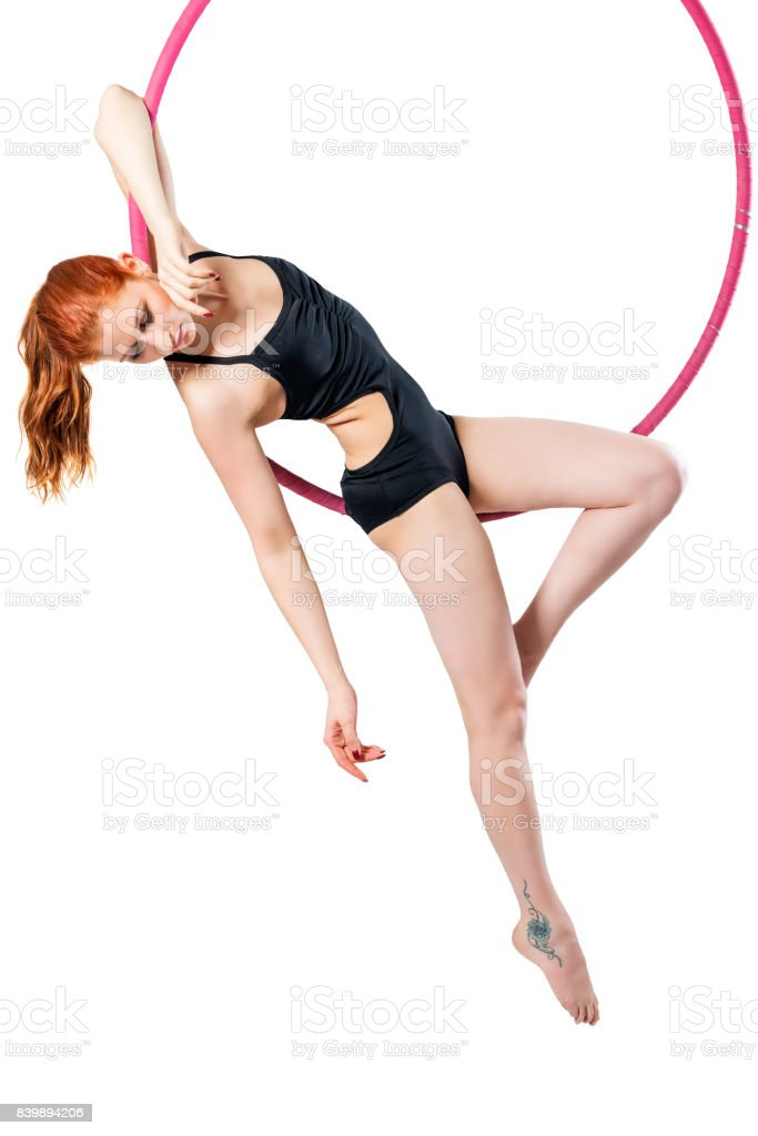 Sensual girl posing in an airy ring on a white background stock photo