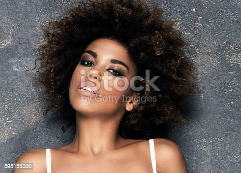 istock Sensual girl with afro in white lingerie. 595158030