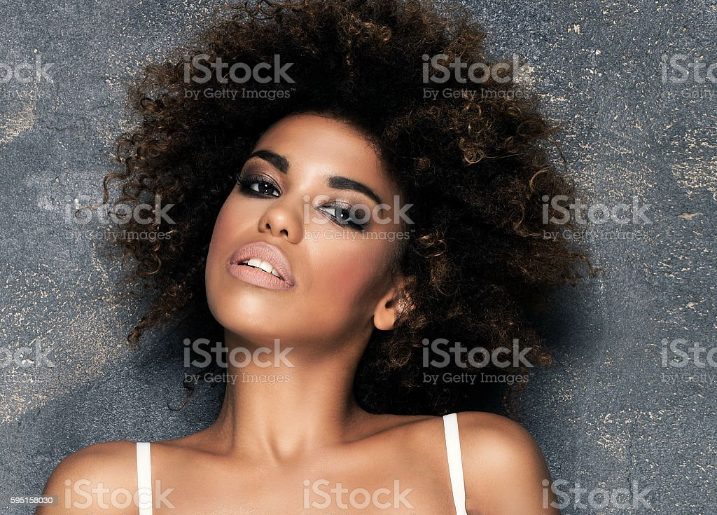 Sensual girl with afro in white lingerie. stock photo