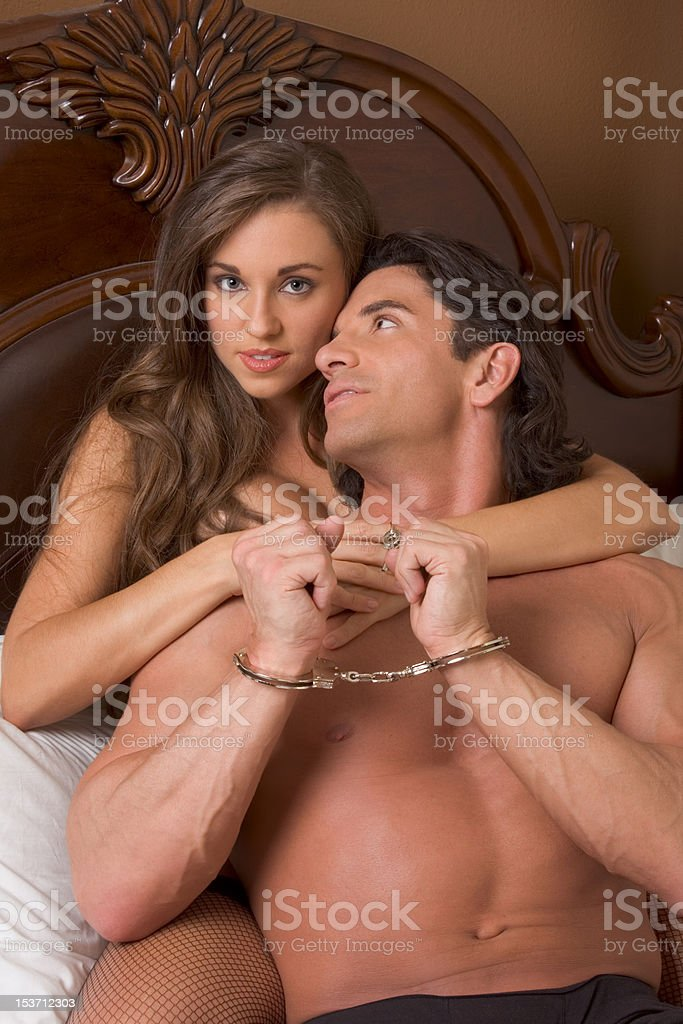 Sensual heterosexual couple in lingerie on bed royalty-free stock photo