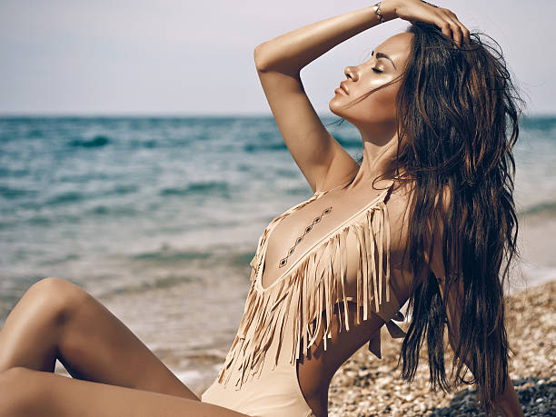 sensual lady at beach - beach fashion stock photos and pictures