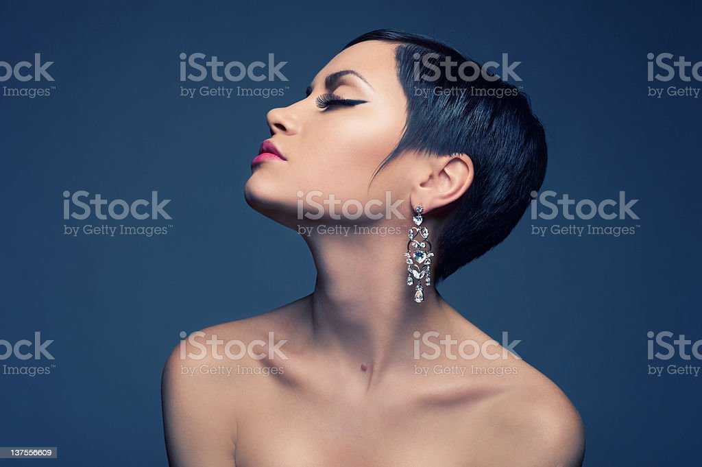 Sensual lady with diamond earring royalty-free stock photo