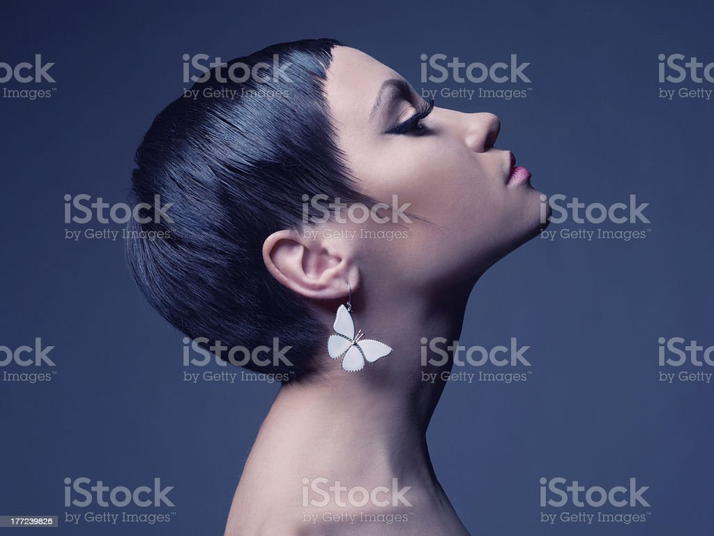 Sensual lady with earring-butterfly stock photo