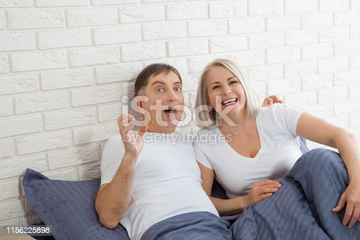 istock Sensual mature couple together in bed. Happy couple in bedroom enjoying sensual foreplay. 1156225898