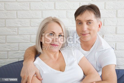istock Sensual mature couple together in bed. Happy couple in bedroom enjoying sensual foreplay. 1163798669